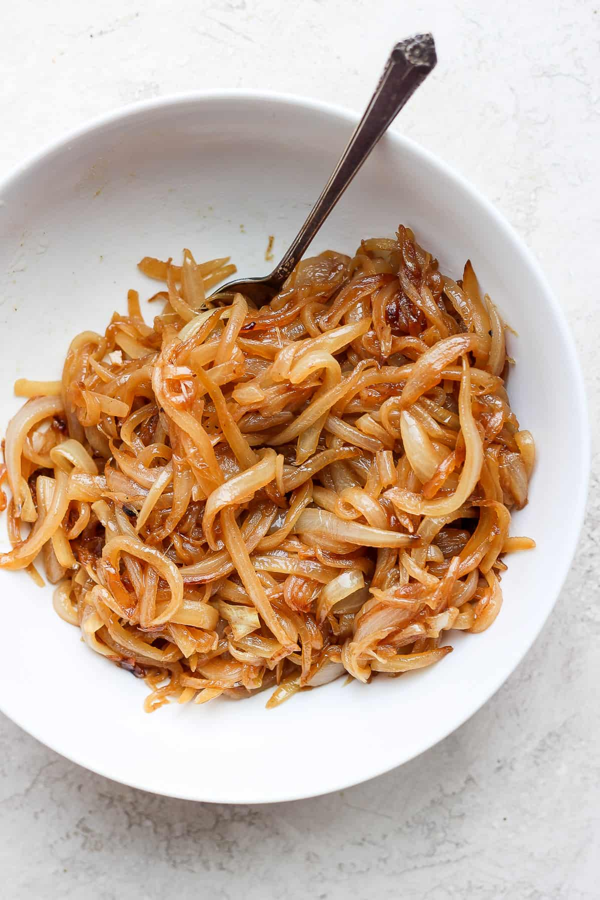 Caramelized onions in a white bowl