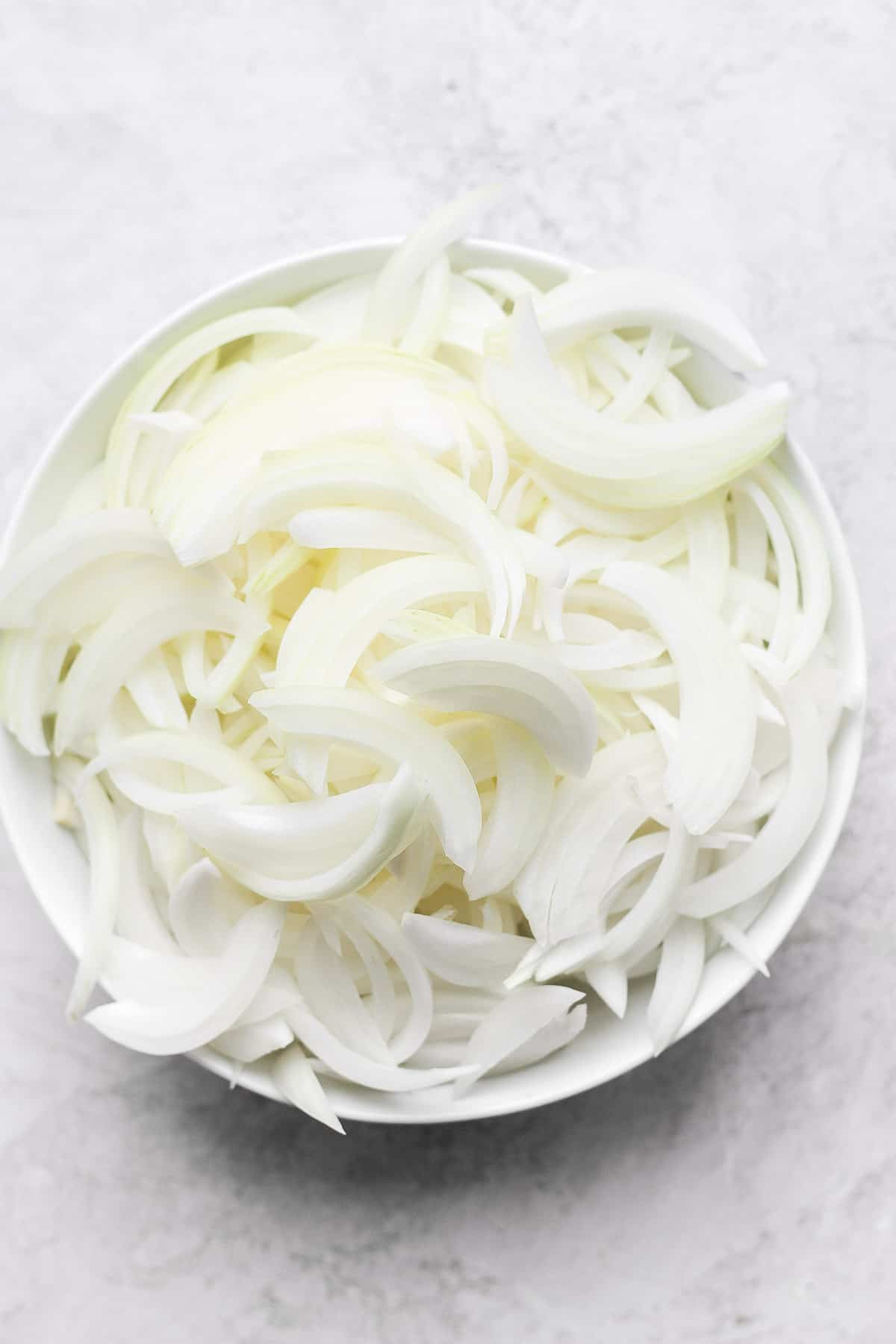 Large bowl of sliced onions