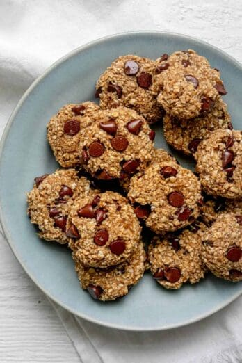 Banana oatmeal cookies on a plate with chocolate chips