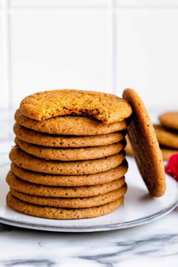 Stack of cardamom spiced cookies on a small plate