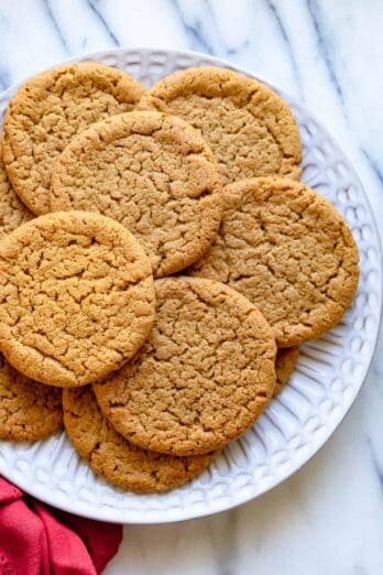 Plate of ginger snap cookies with red napkin on the side