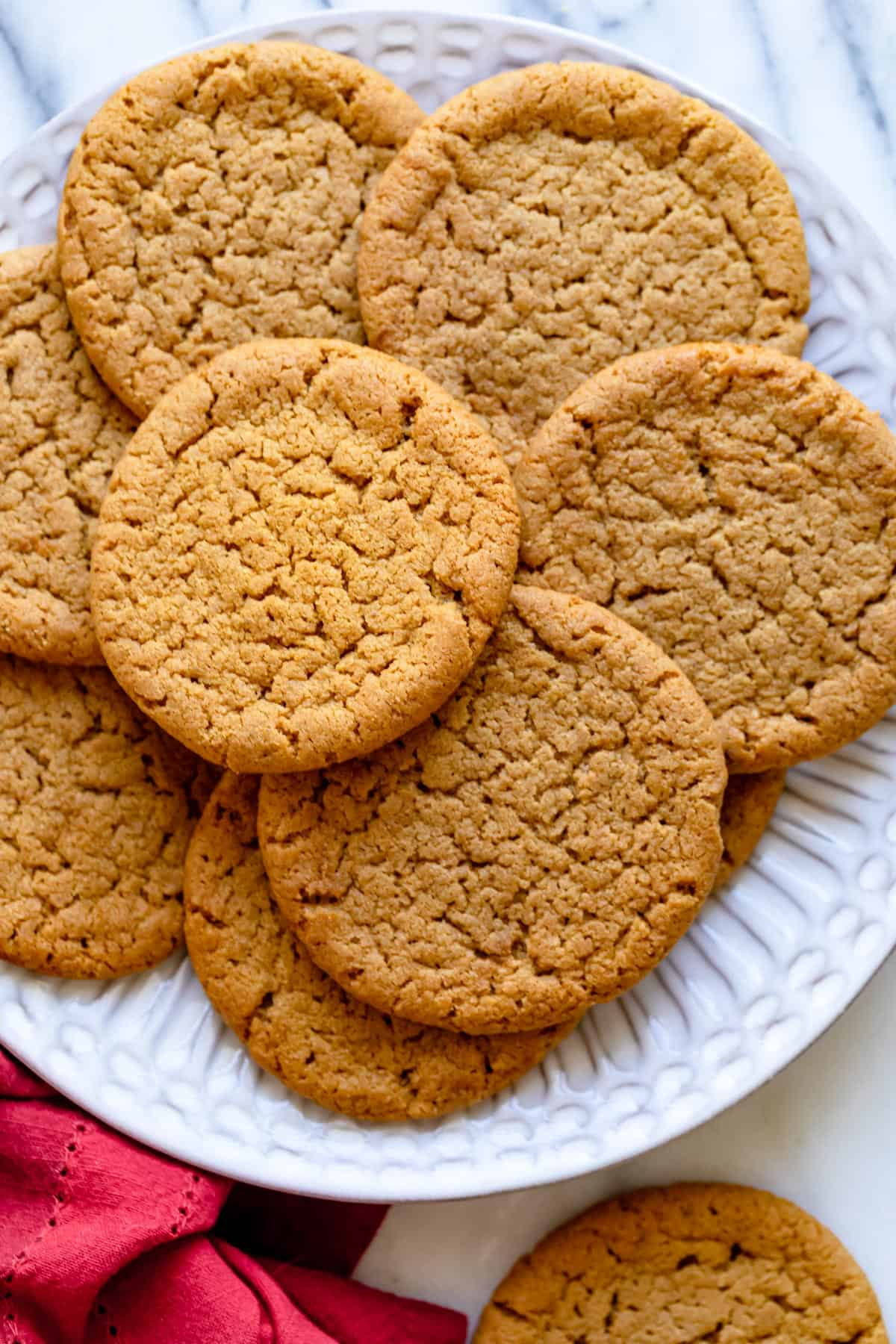 Large plate of ginger snap cookies after on marble background
