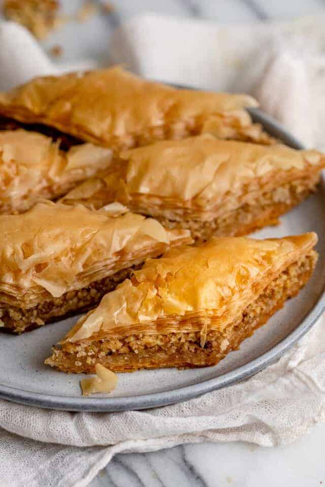 Side angle shot of sliced pieces of baklawa on a plate
