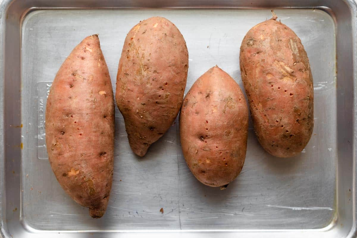 4 sweet potatoes on baking pan