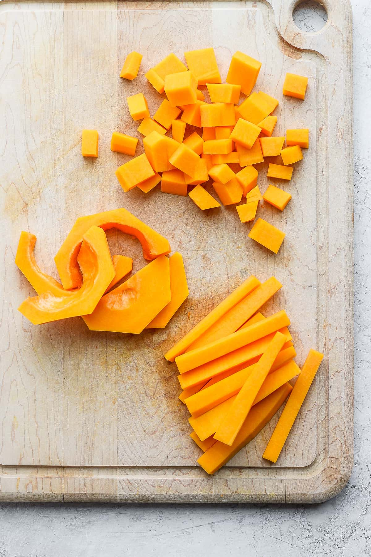 3 types of ways to cut butternut squash shown on a cutting board
