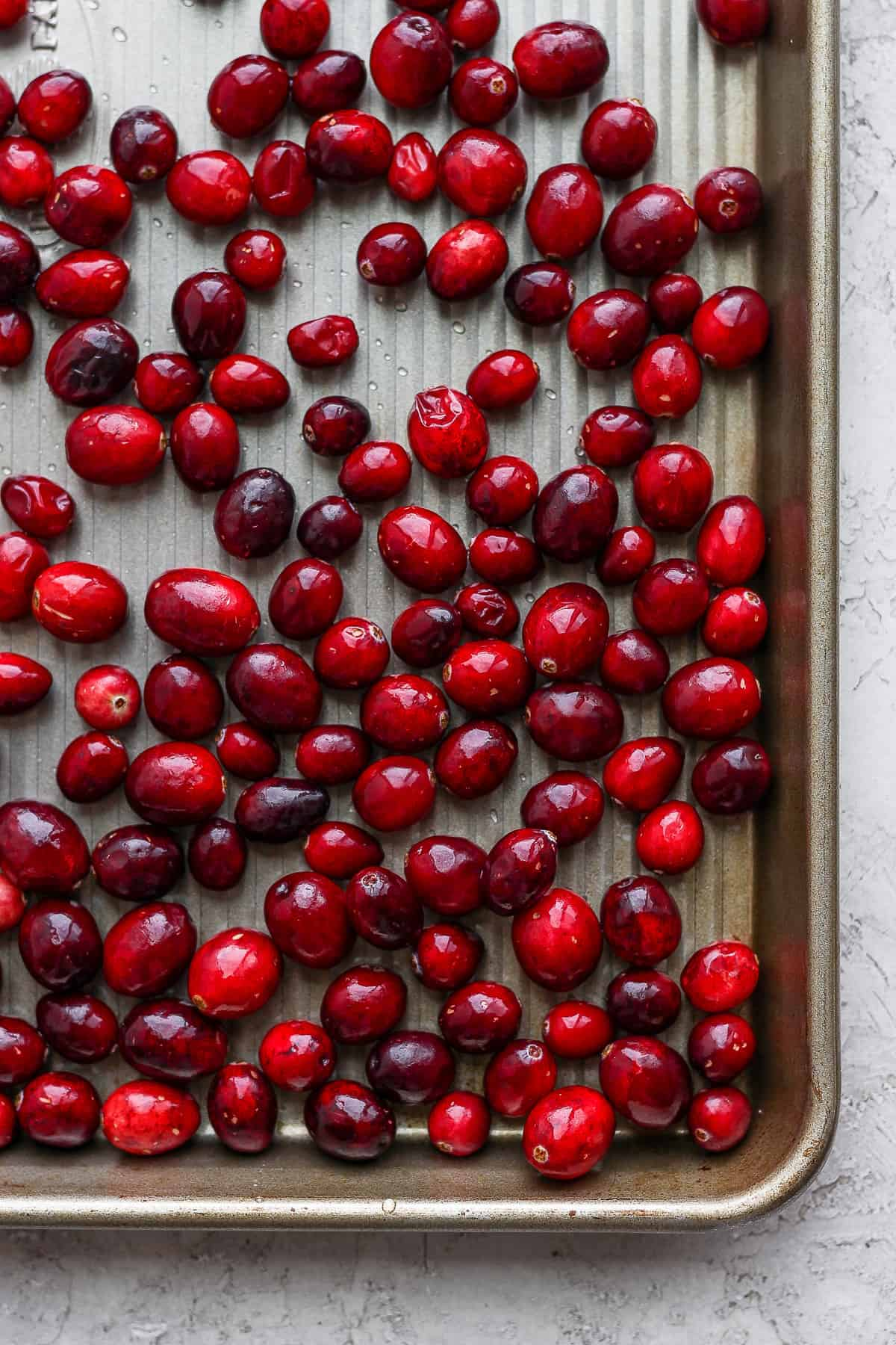 Close up shot of the cranberries frozen on a baking tray