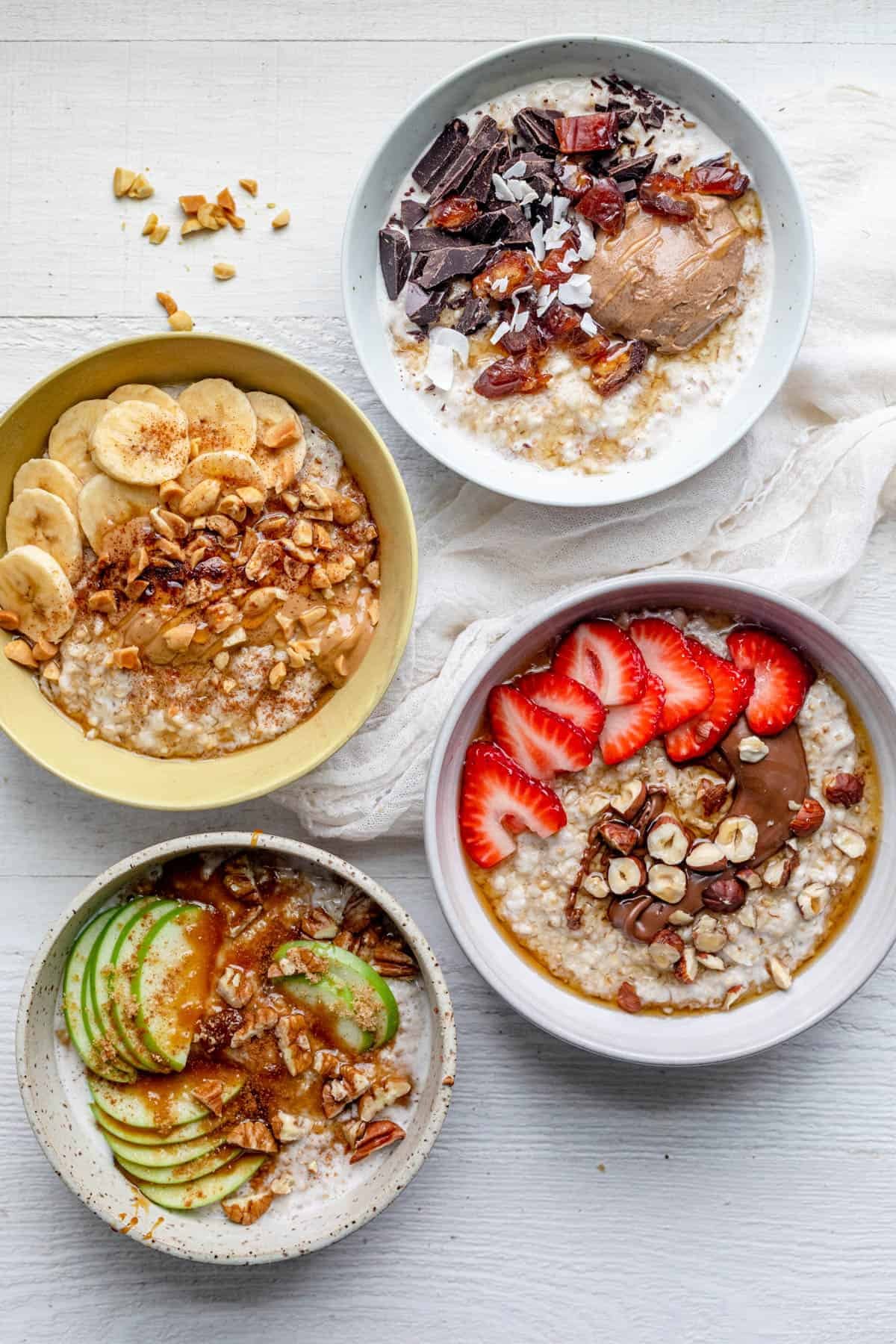 4 bowls of overnight steel cut oats with different toppings