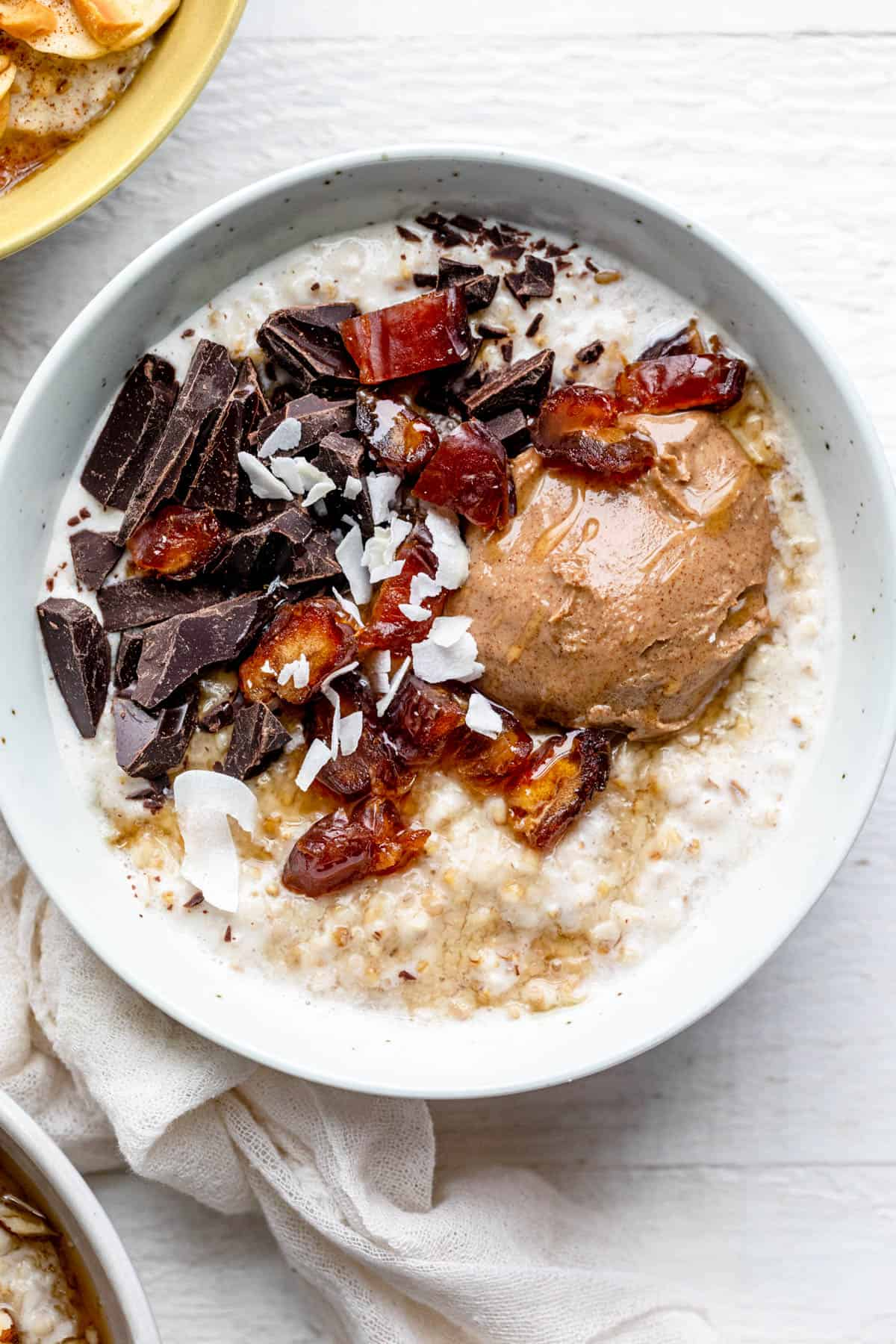 Almond butter, chocolate, dates and coconut over oatmeal