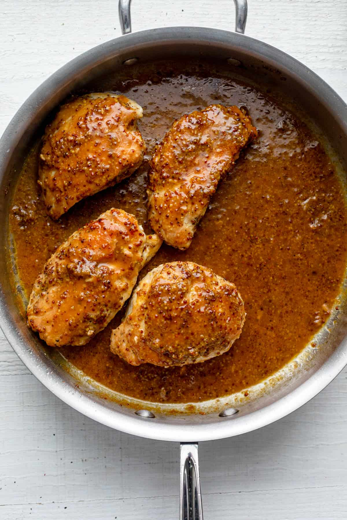 Completed honey mustard chicken in pan with sauce