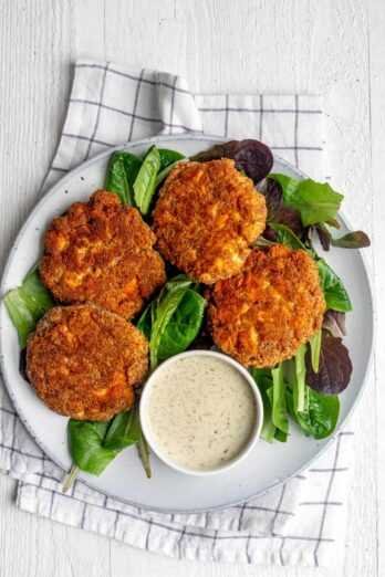 Plate of 4 salmon cakes with mayo dipping sauce