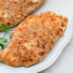 Close up of breaded chicken on a plate