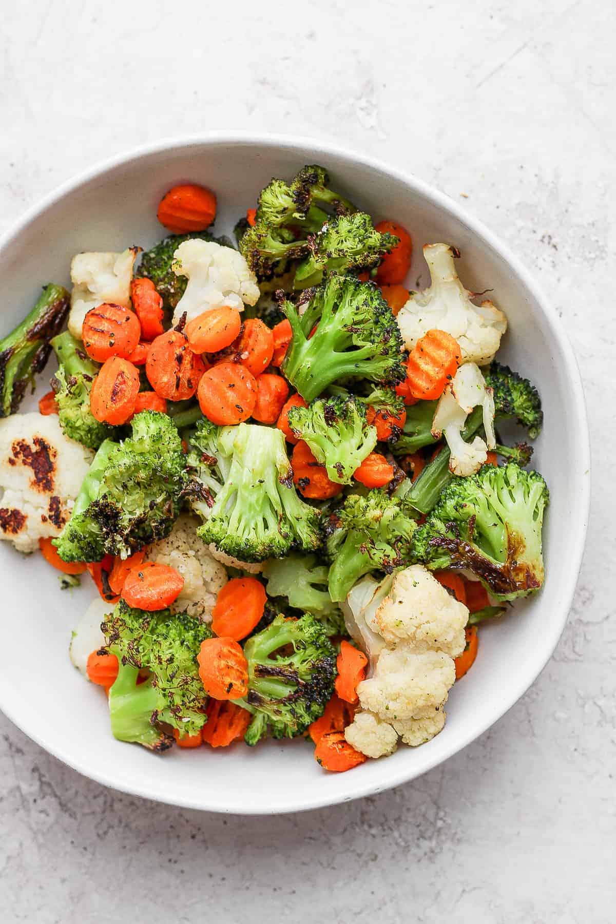 Roasted vegetables in a large bowl
