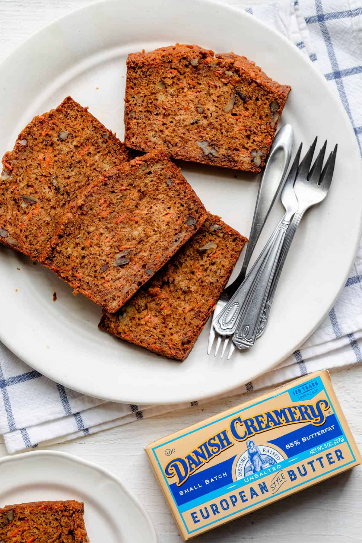 Carrot banana bread served on a plate with Danish Creamery packaging next to it