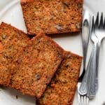 Carrot banana bread on a large white plate with small forks