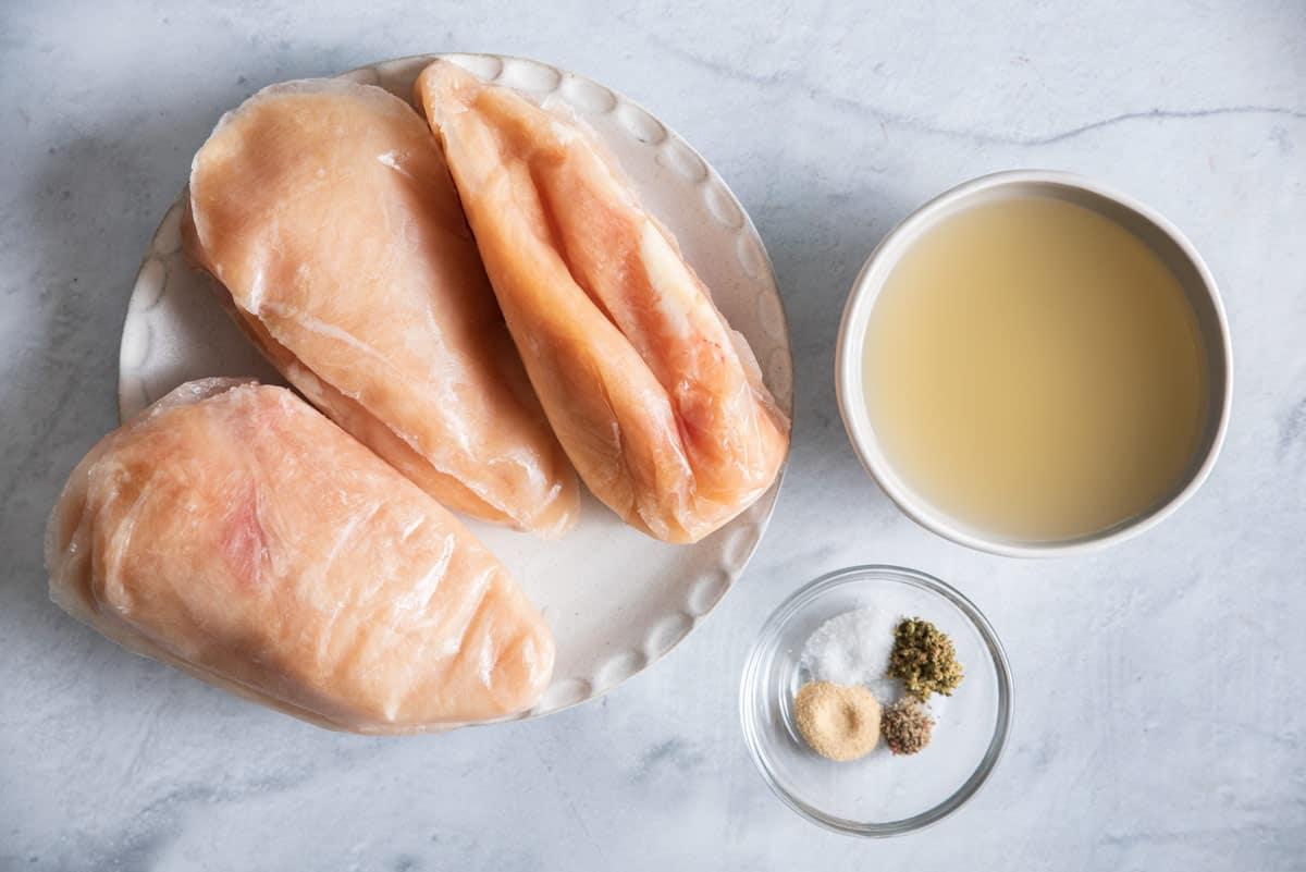 Frozen chicken breasts, chicken stock and seasoning