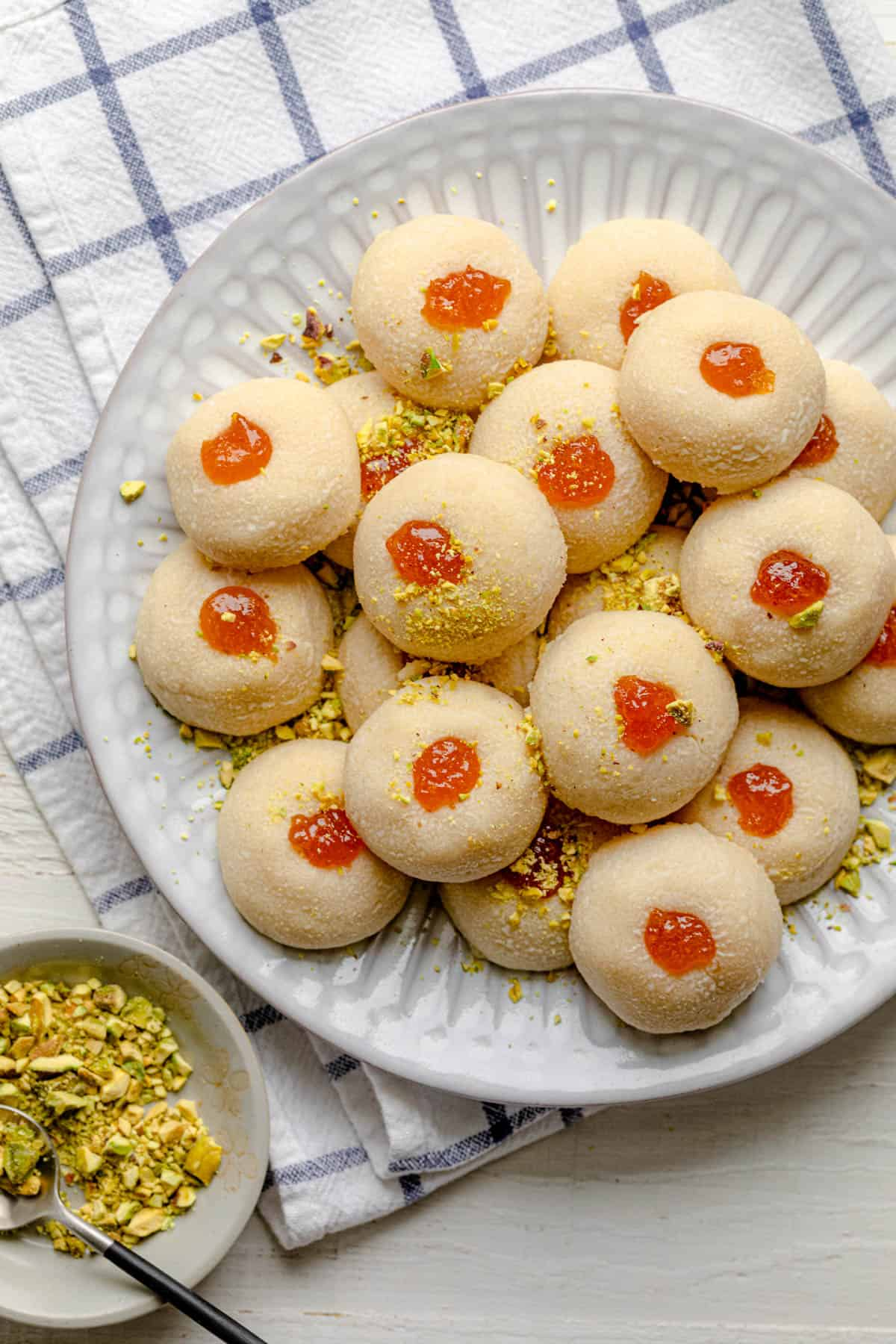 Large plate for ghraybeh shortbread cookies with pistachios on the side
