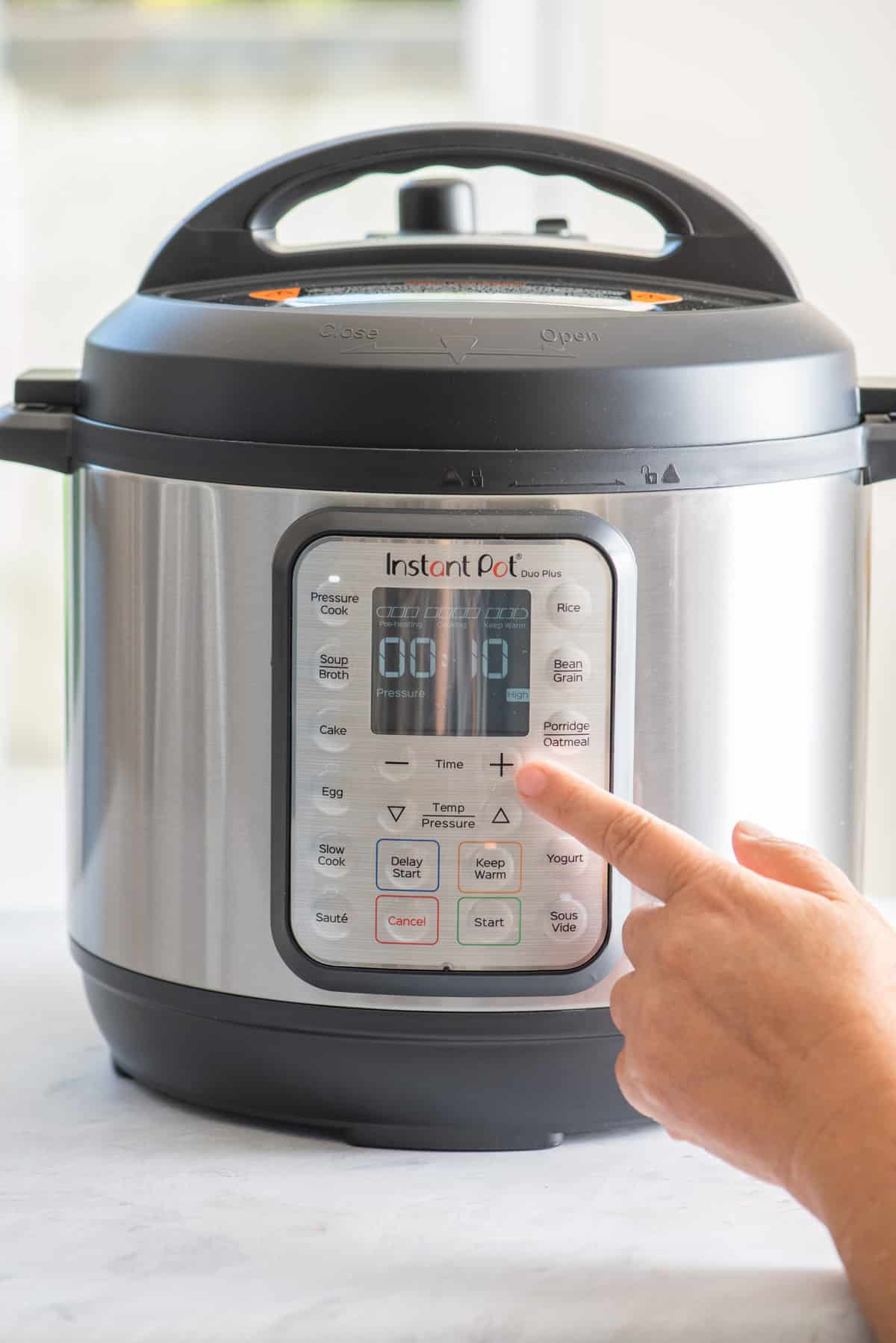 Selecting timer on Instant Pot for the chicken recipe