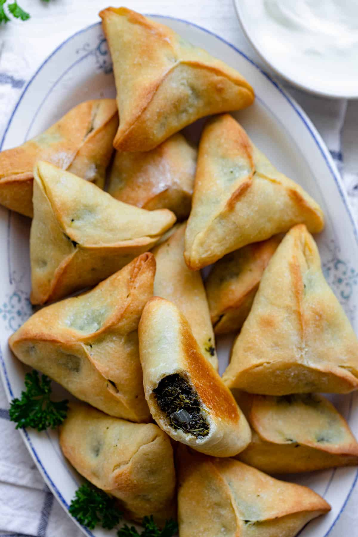 close up of spinach pies on a plate