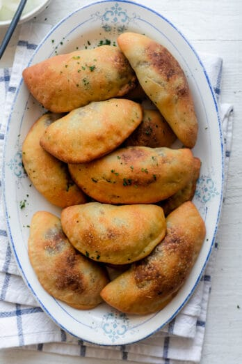 Sfeehas or Lebanese meat pies on a serving dish