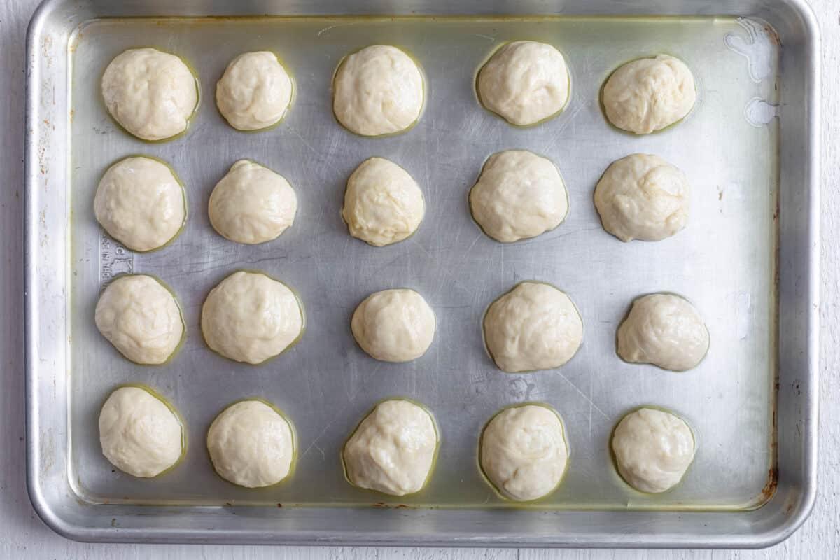 Dough balls on greased pan