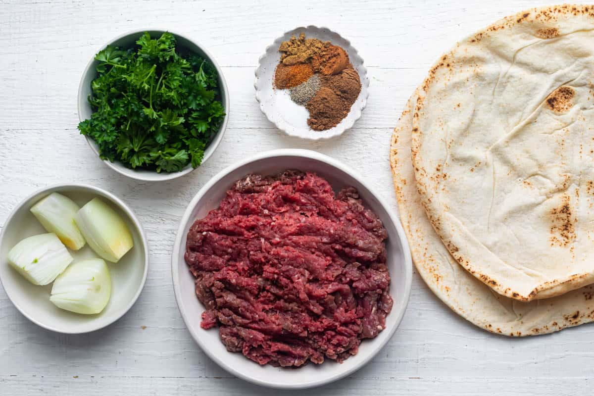 Ingredients to make the recipe: ground beef, onions, parsley, spices and pita