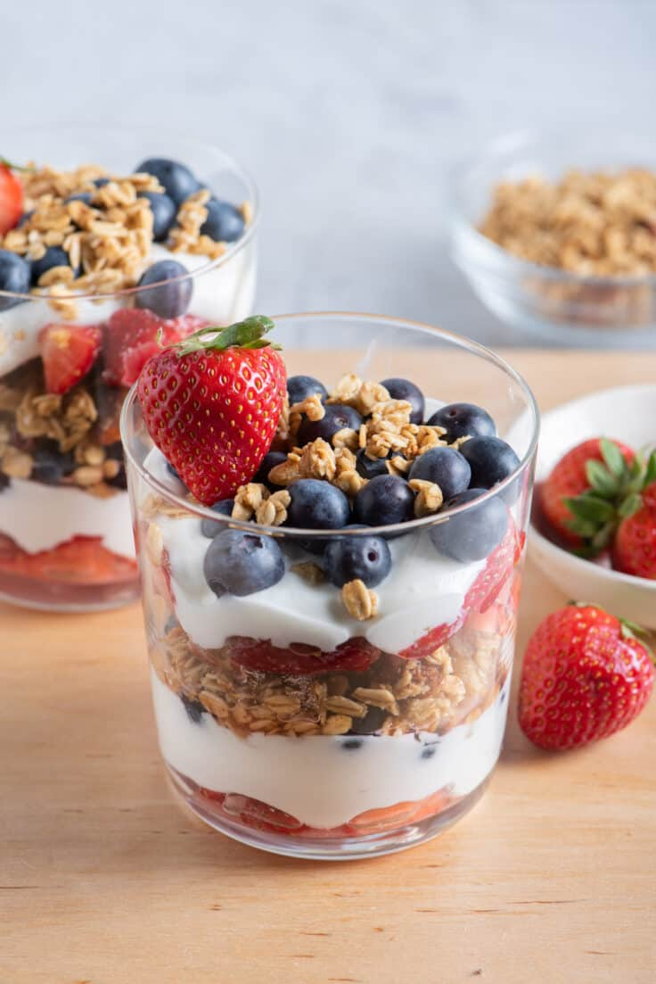 Fruit and yogurt parfait with red, white and blue fruits layered