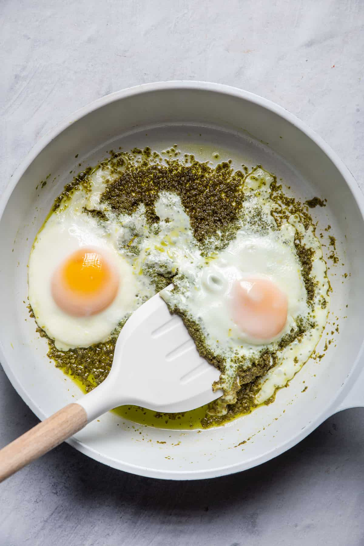 Spatula sliding under eggs after they're cooked