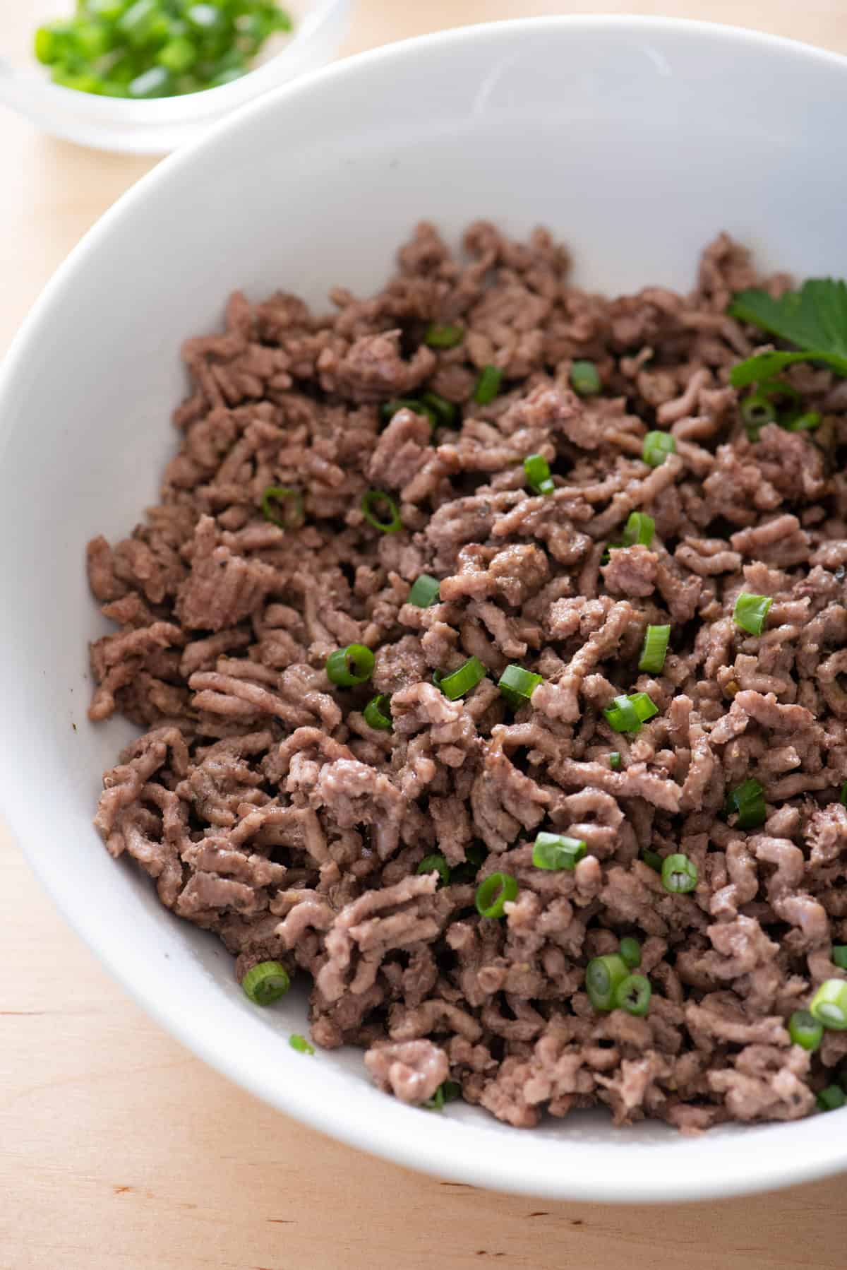 Instant pot ground beef served in large white bowl