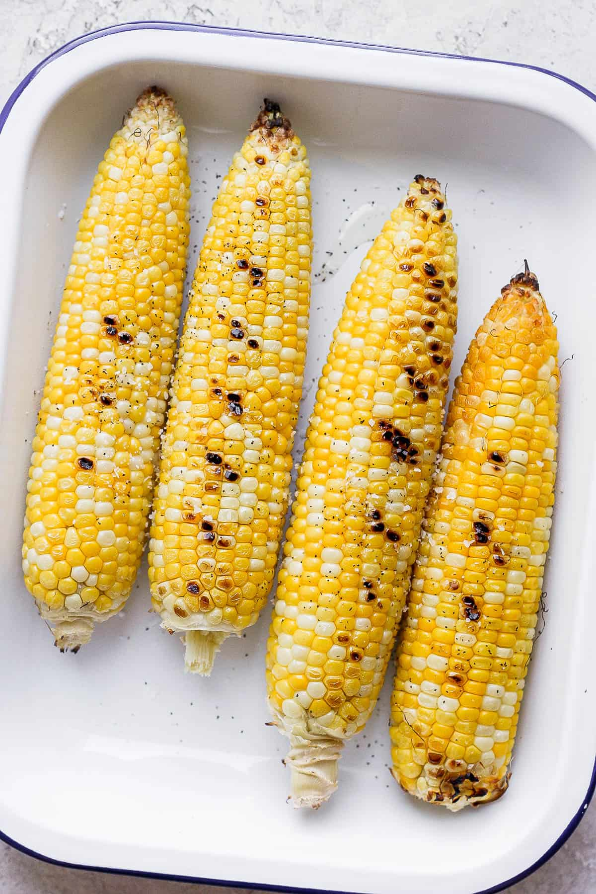 Pan of 4 grilled corn without husks