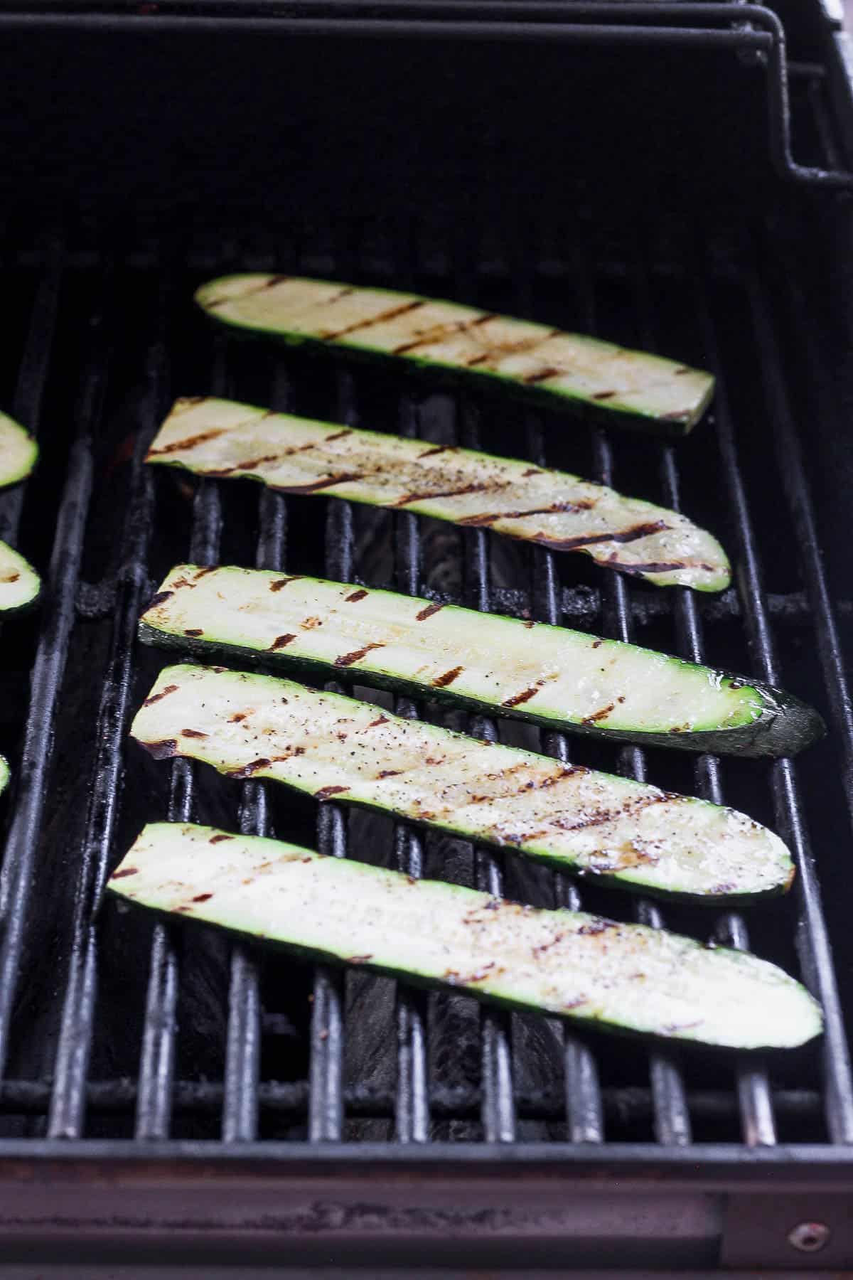 Grilled zucchini slices on outdoor grill