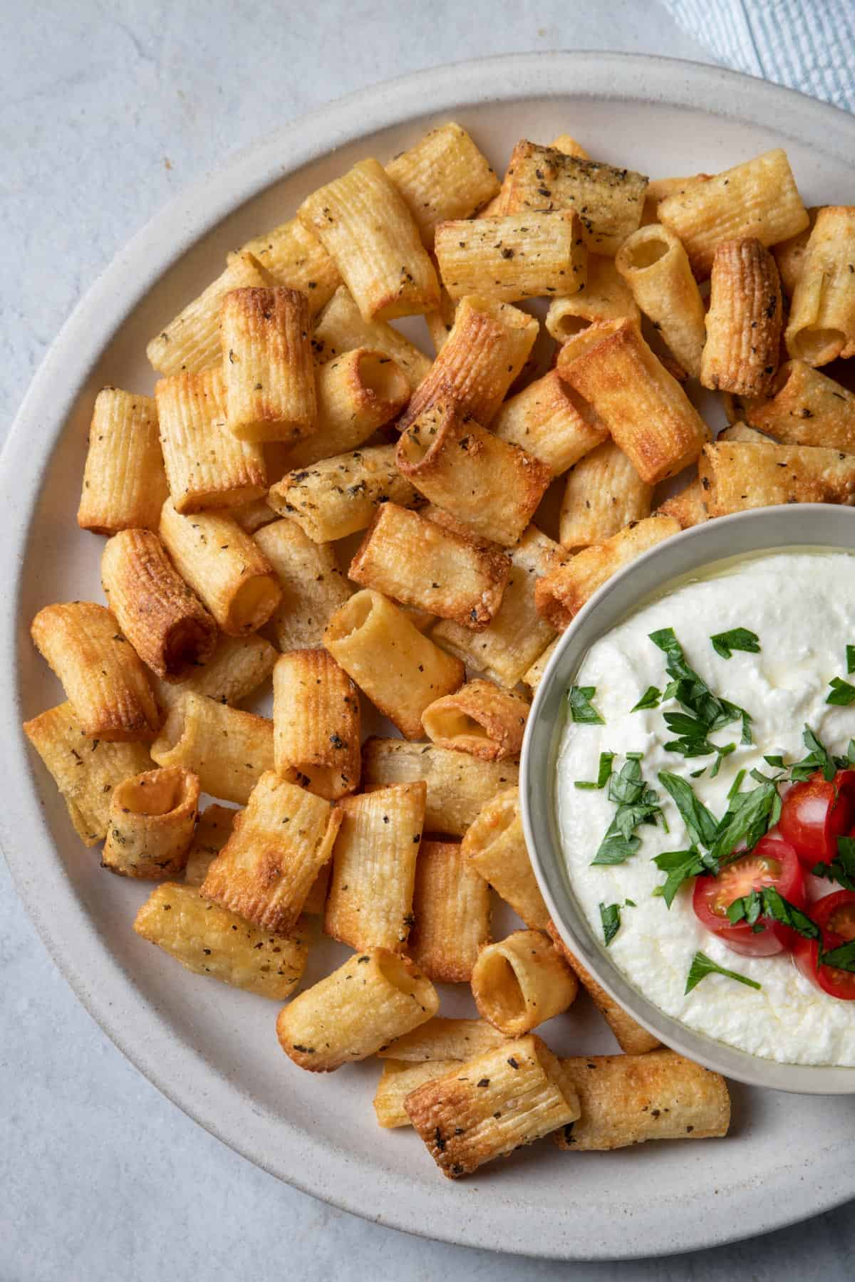 Close up shot of the pasta chips with the whipped feta dip