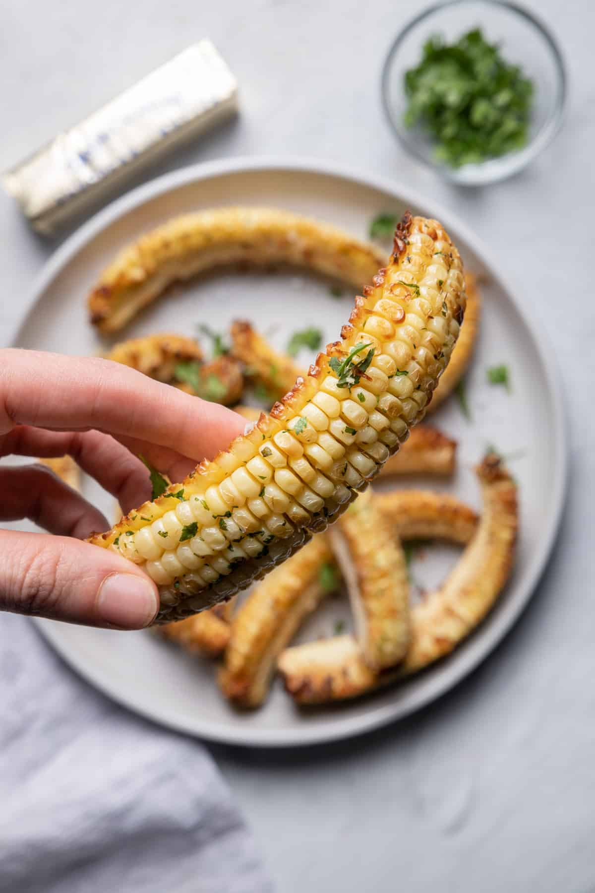 Hand holding corn ribs to show close up how it looks