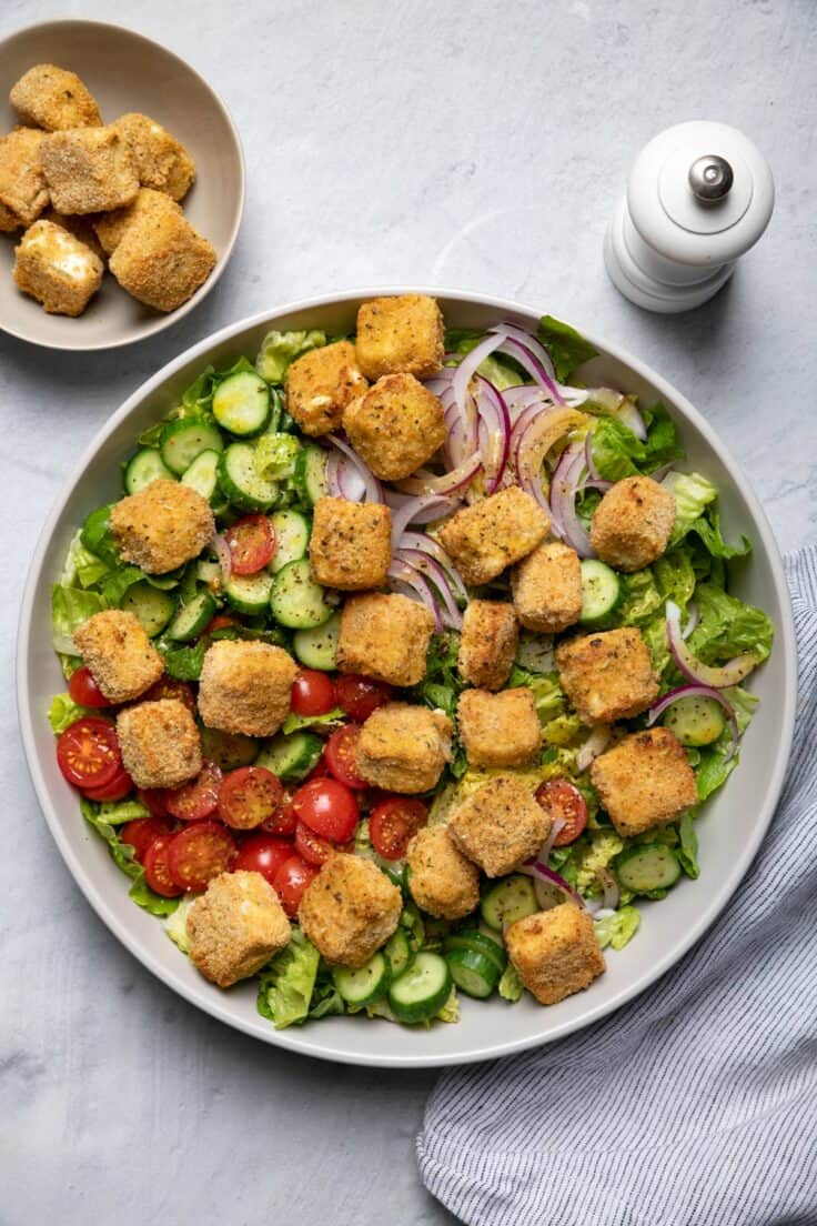 Large bowl of salad with air fried feta cheese croutons