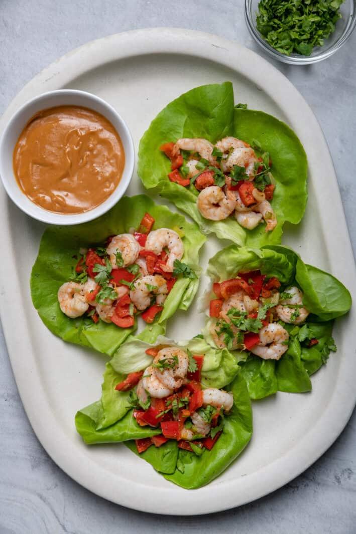 Shrimp lettuce wraps on platter served with peanut sauce