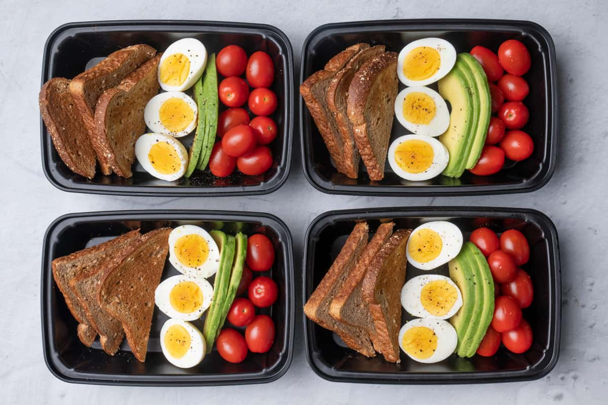 4 containers of Avocado and Egg Breakfast Meal Prep