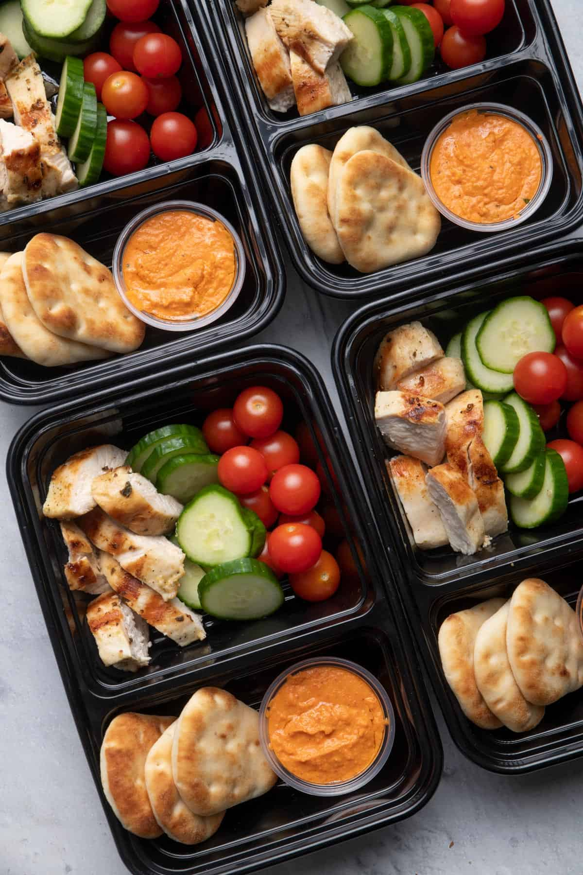 Meal prepped grilled chicken with hummus and veggies