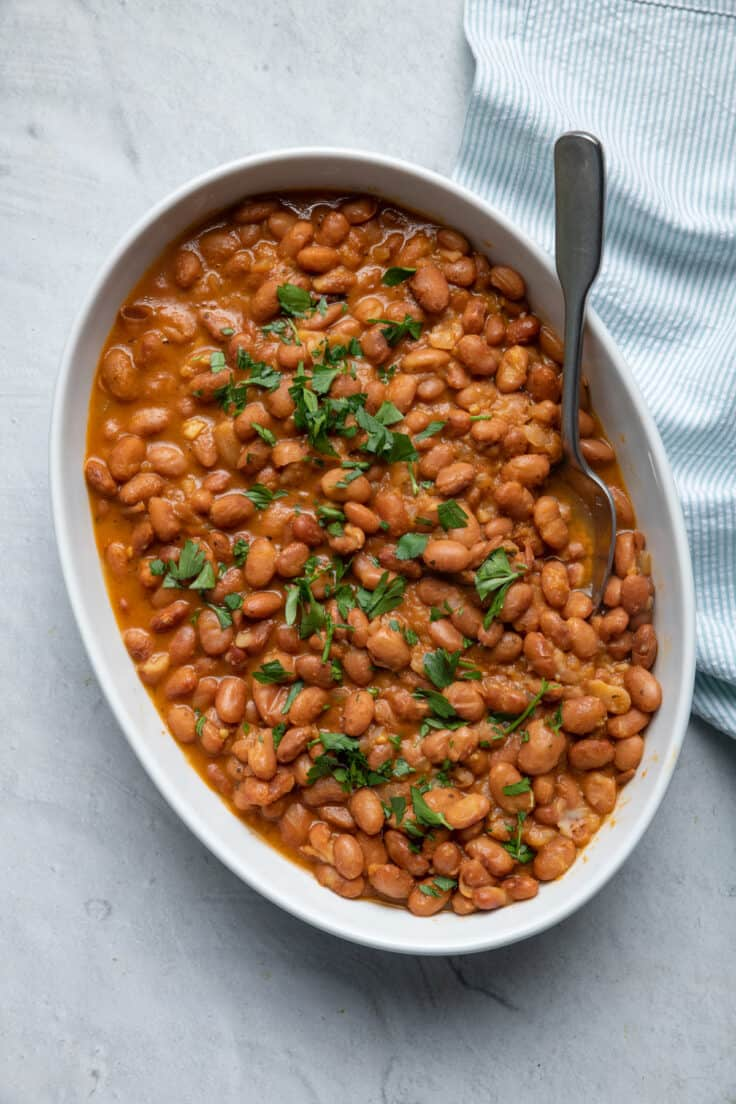 Large dish of instant pot baked beans garnished with parsley