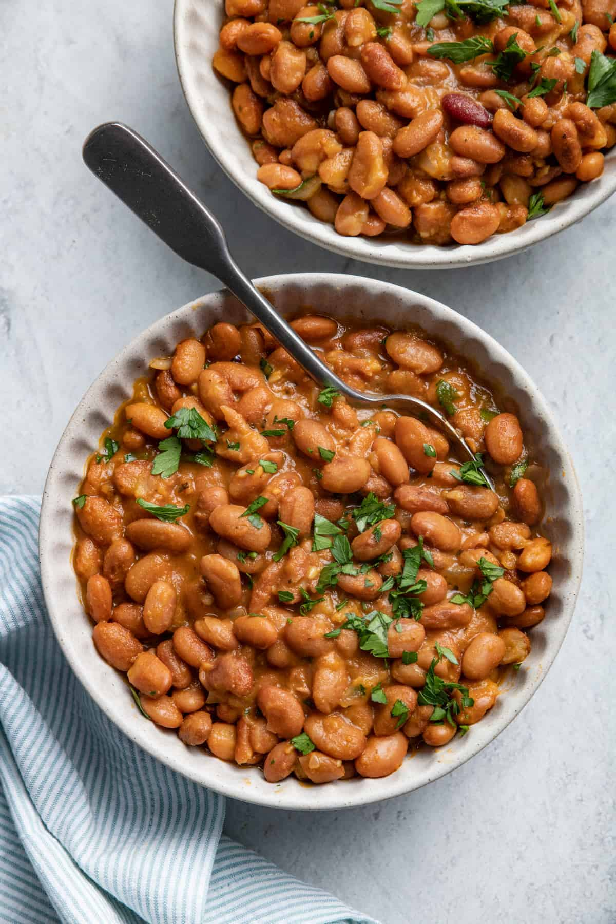 Two bowls of baked beans