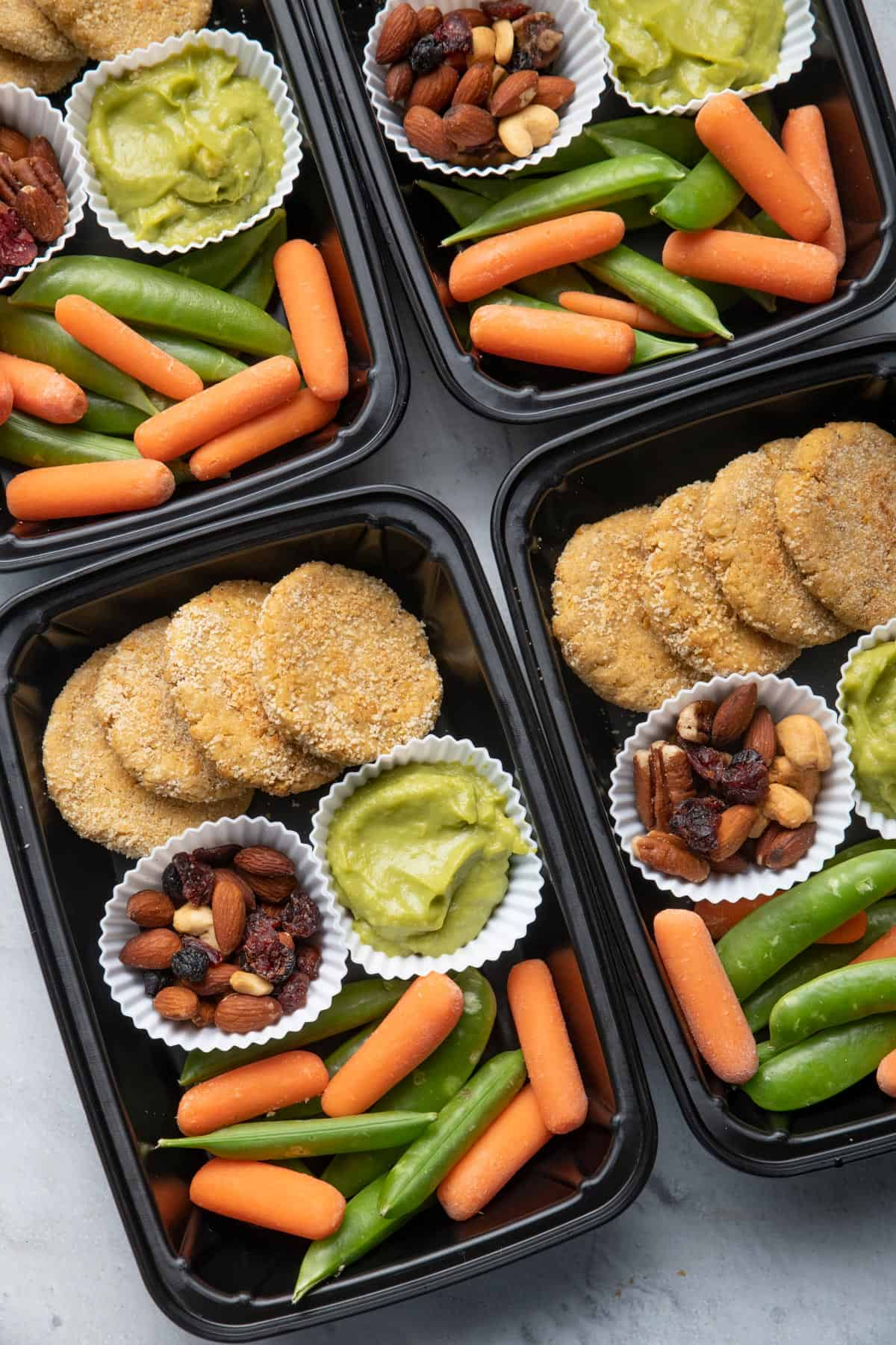 Meal prep containers with chickpea bites and avocado