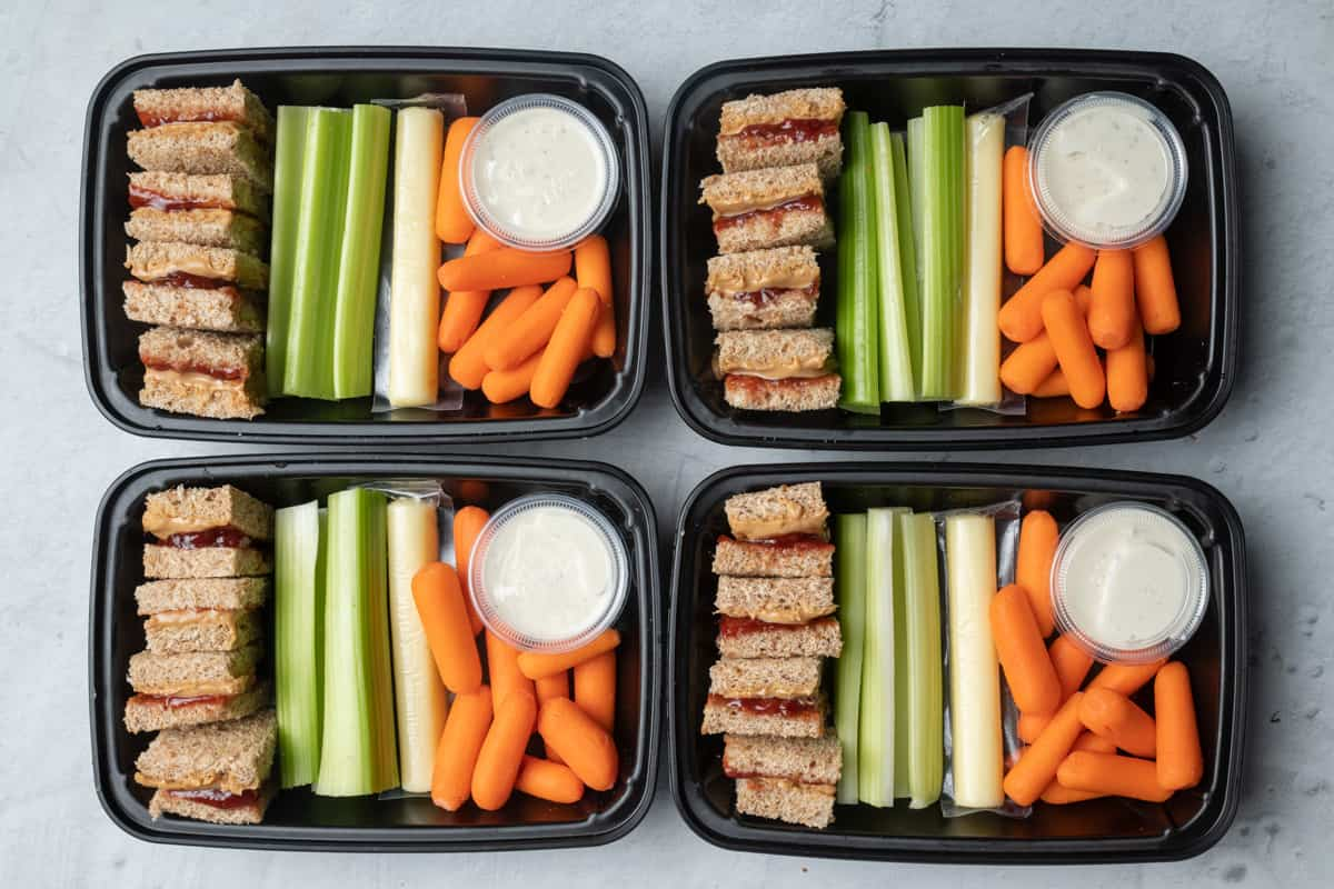 PB&J meal prep containers with veggies
