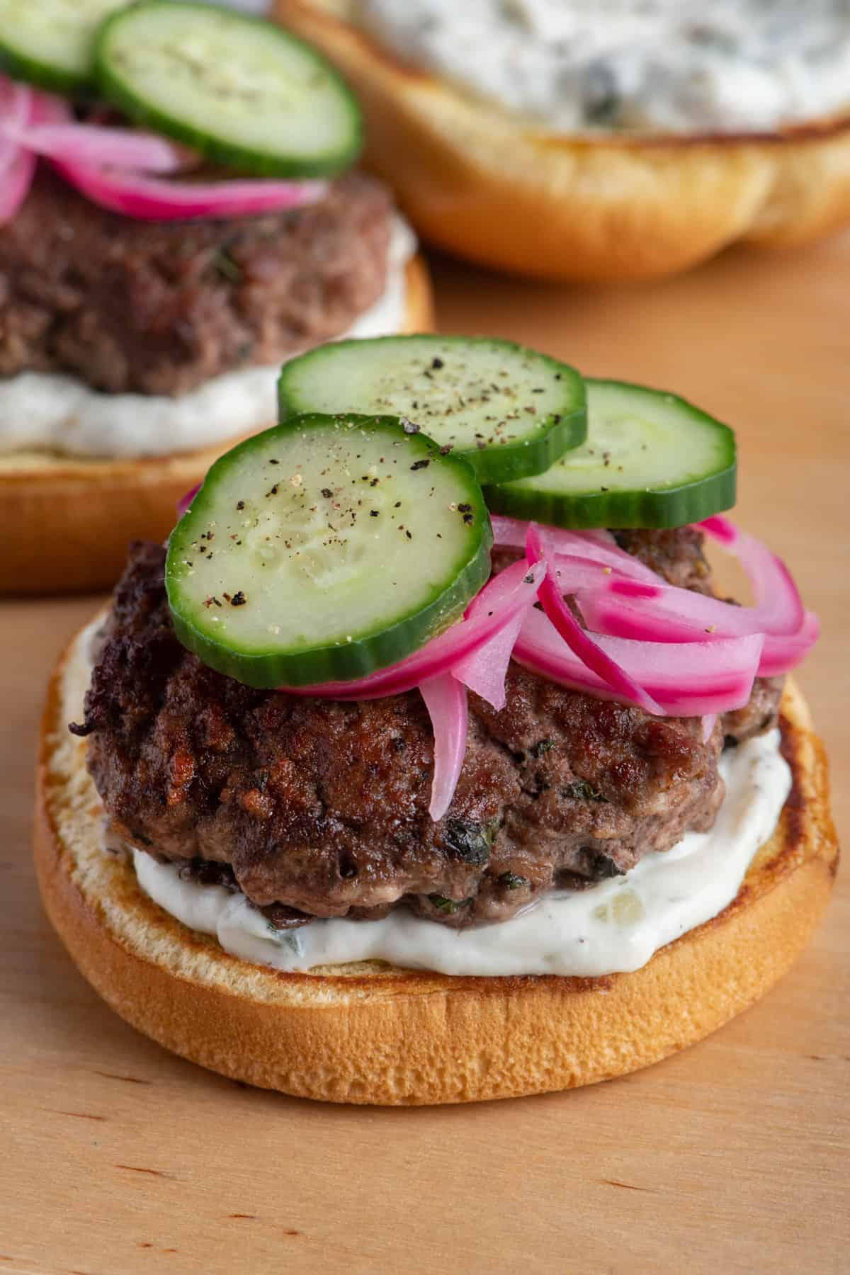 Opened lamb burgers on cutting board
