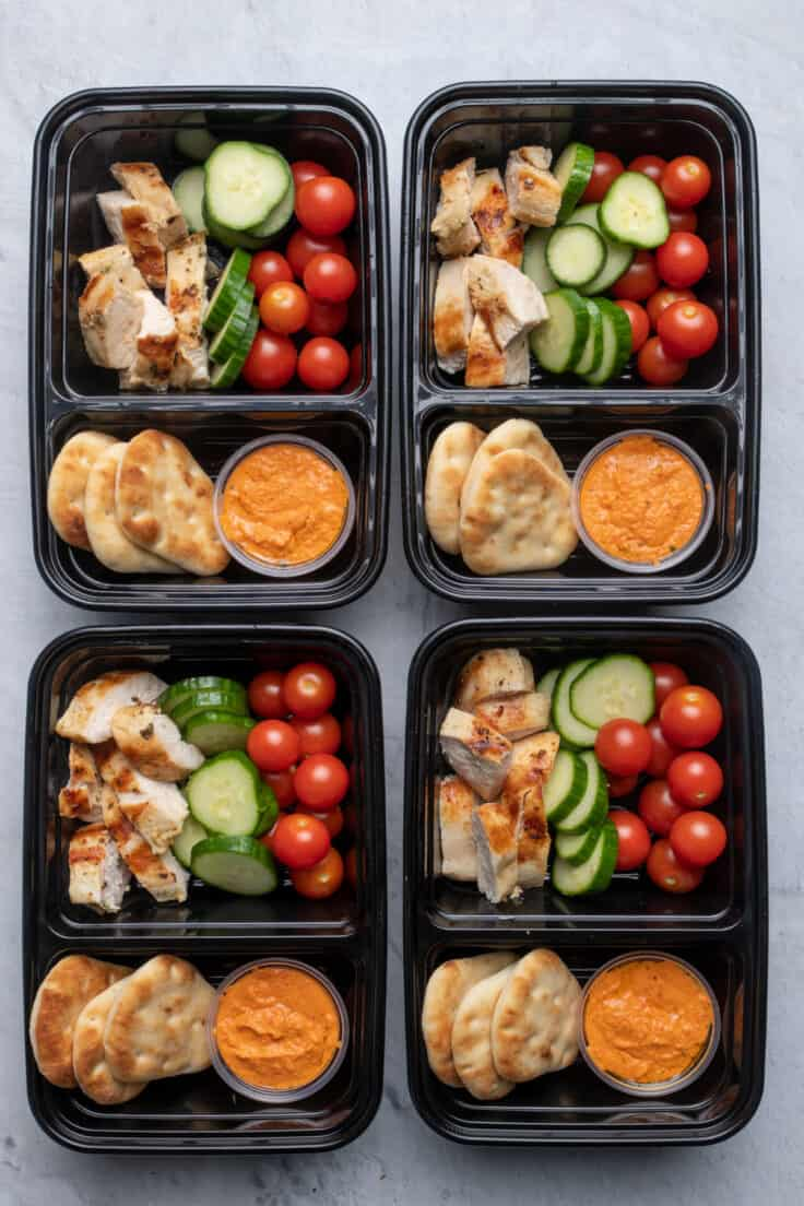 Grilled chicken and hummus meal prep containers
