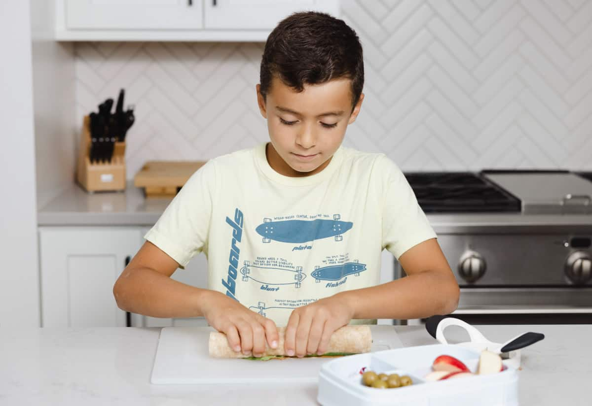 Adam wrapping sandwich to put in lunchbox