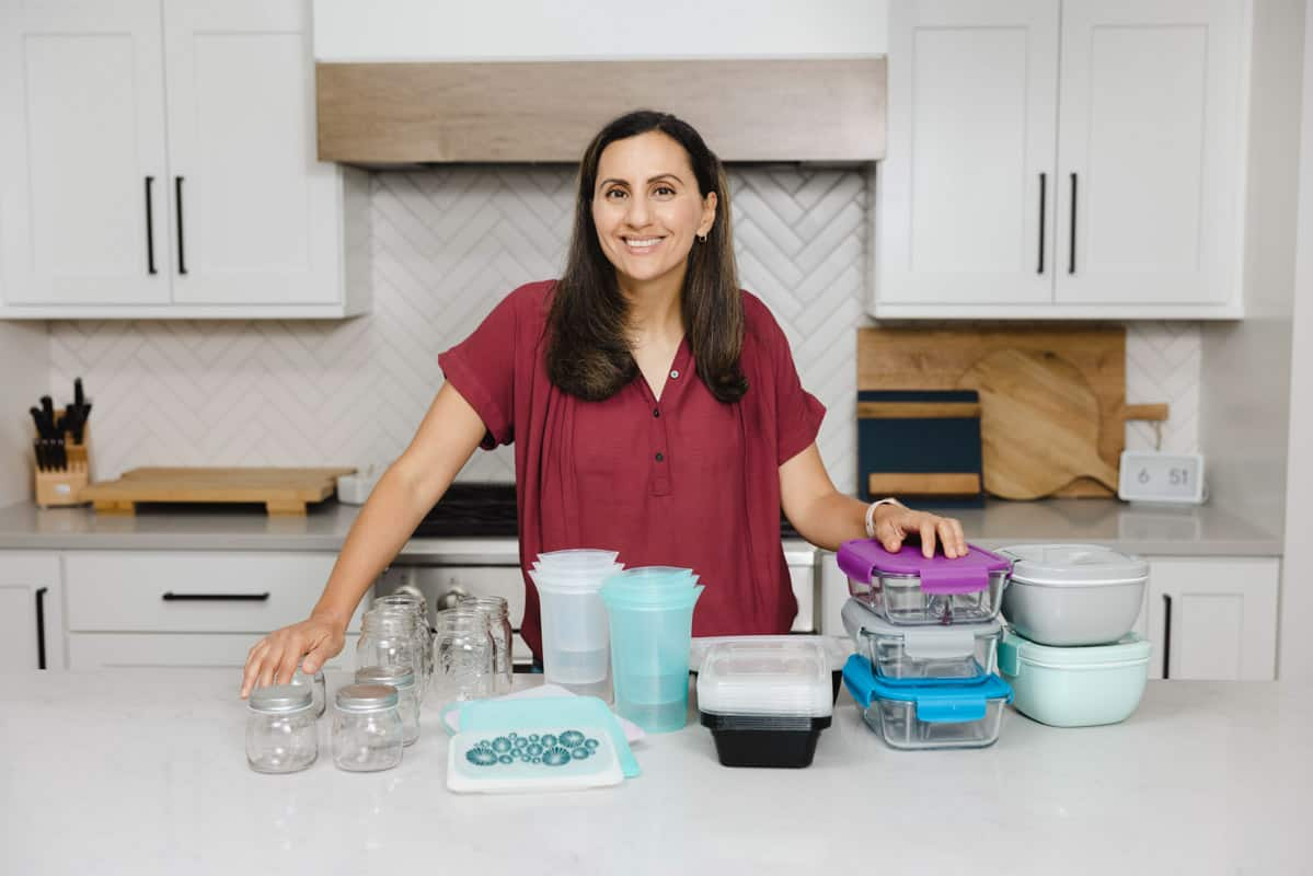 Yumna in kitchen with lots of different meal prep containers on the countertop