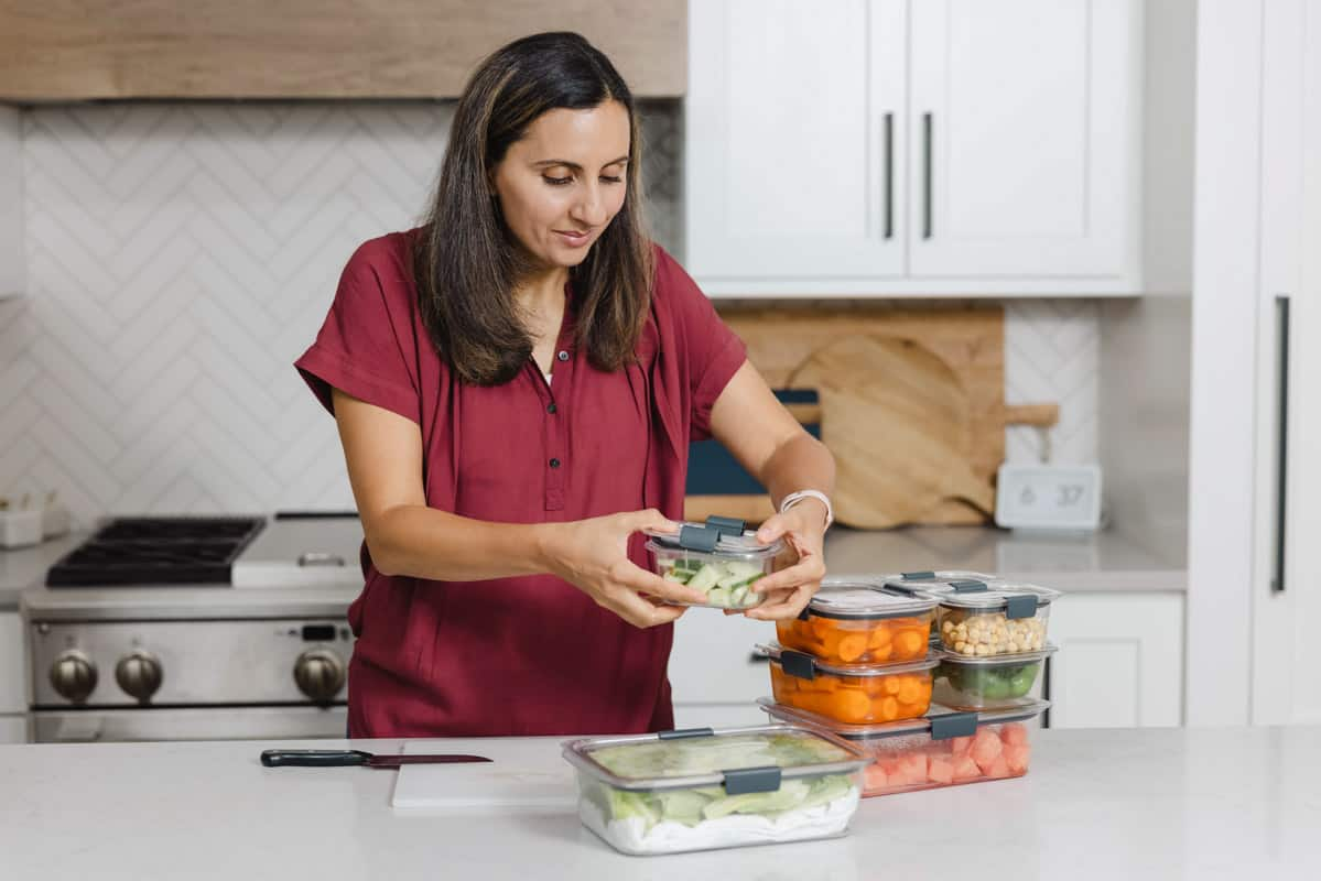 Preparing fruits and vegetables into meal prep containers