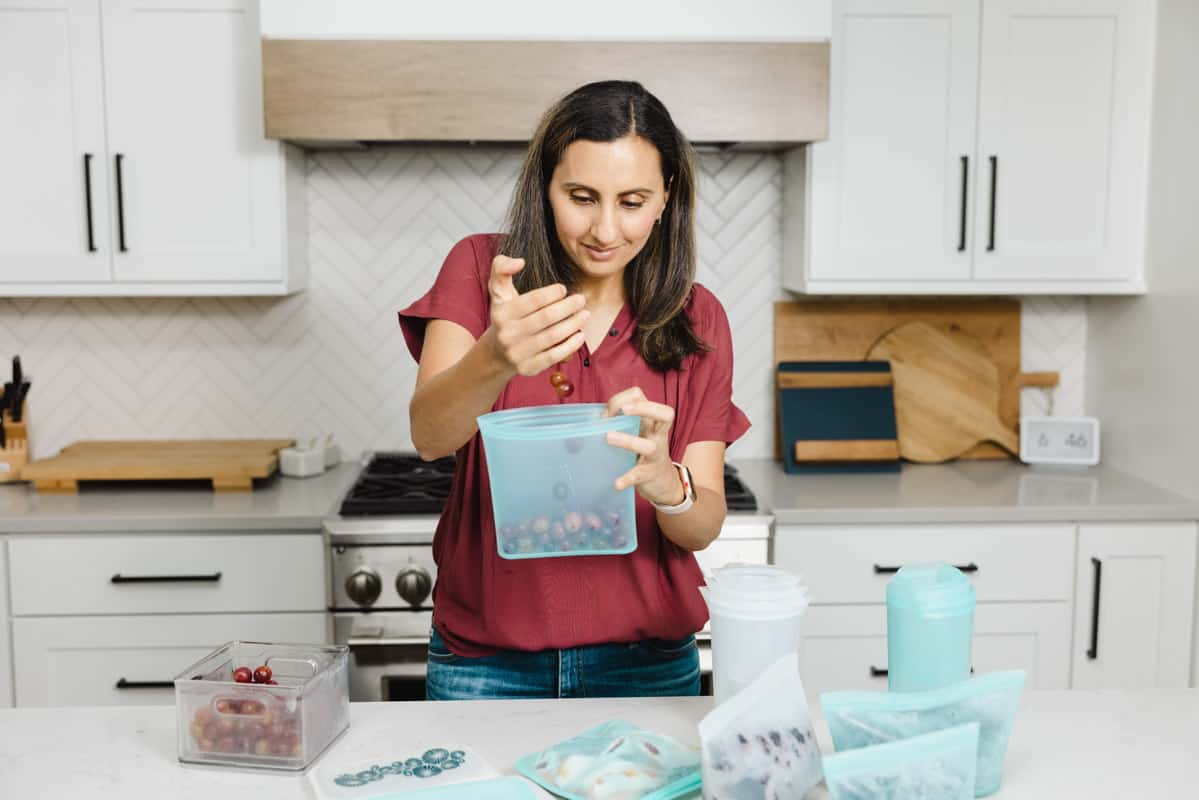 Adding blueberries into meal silicone bags